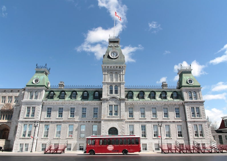 Show item 2 of 8. Kingston trolley parked in front of Mackenzie Building on a sunny day