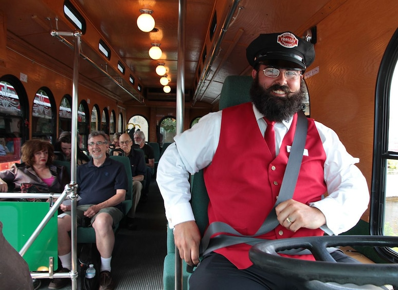 Show item 8 of 8. Driver poses on Kingston Trolley