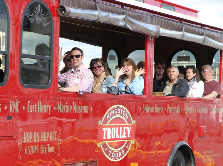 Show item 3 of 8. Passengers wave from Trolley in Kingston