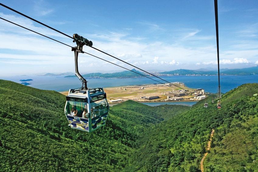 Show item 1 of 10. Skip-the-Line Lantau Island Cable Car Ride & Tai O Boat Ride