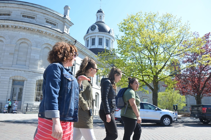 Show item 1 of 10. Tourists walk past government City Hall in Kingston, Canada