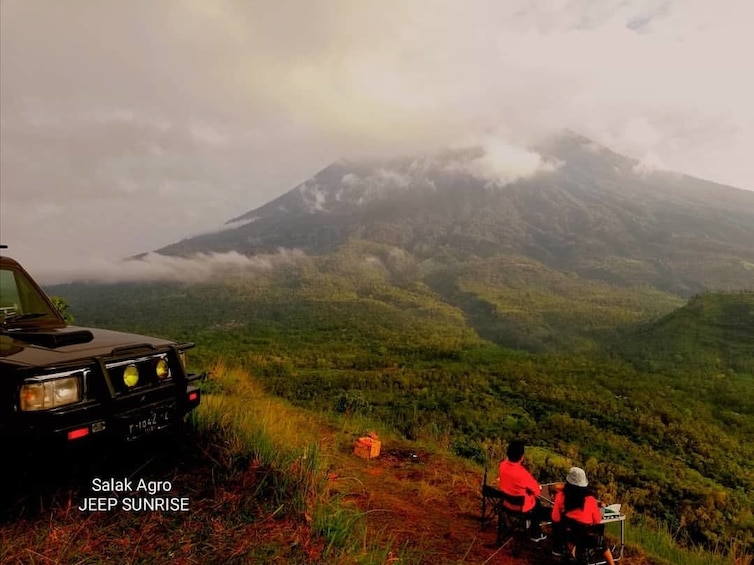 Jeep parked in mountains on a hazy morning in Bali