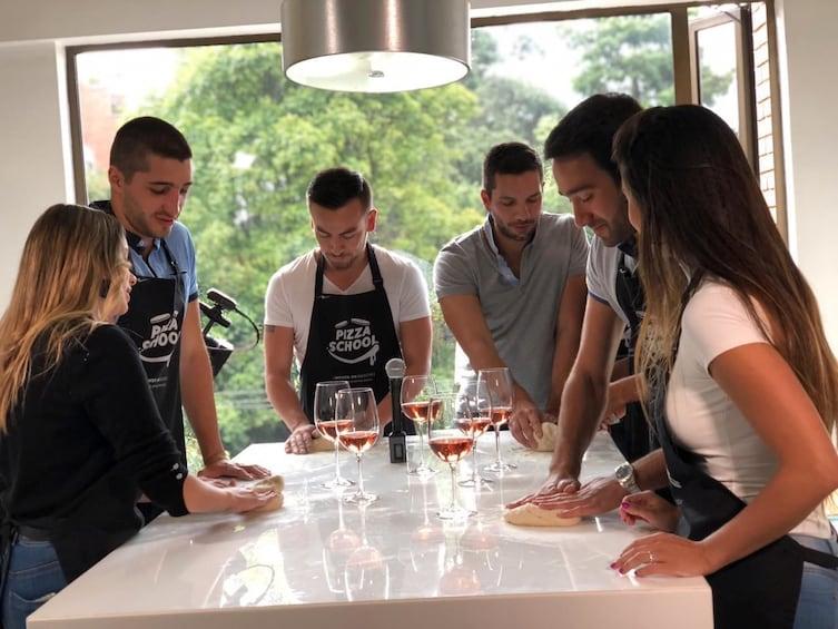 Show item 5 of 5. Private Pizza Workshop + Bottle of wine + transportation.