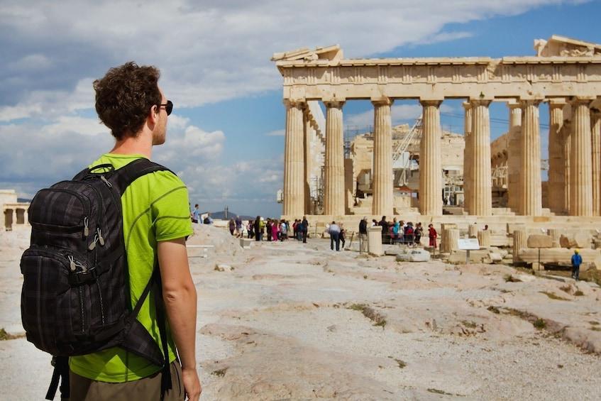 Tourist visiting the Parthenon, Acropolis ruin, Athens, Greece