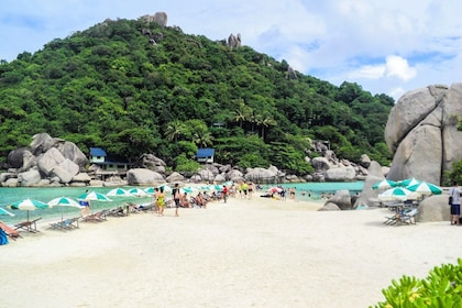 Tourists on secluded beach in Thailand