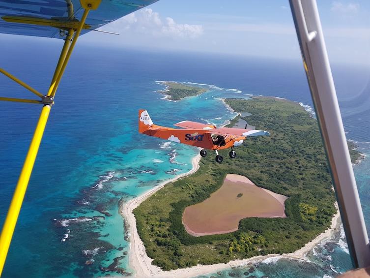 Show item 1 of 9. Scenic Flight ULM: Pointe des Châteaux - Petite-Terre
