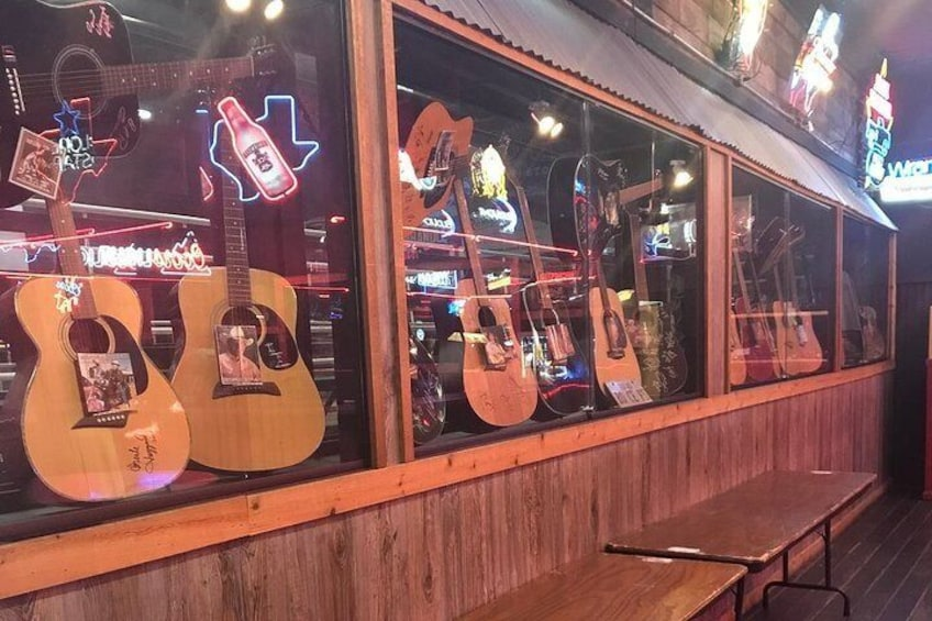 Find autographed guitars in the Guitar Bar