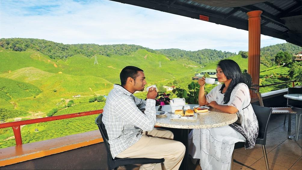 Couple enjoying tea in the Cameron Highlands