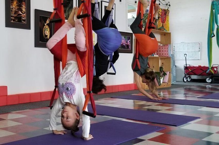 Show item 6 of 6. Yoga Trapeze Aerial Yoga class at Gravity Yoga