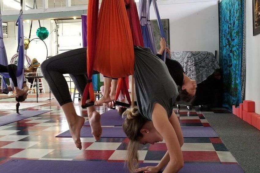 Show item 2 of 6. Yoga Trapeze Aerial Yoga class at Gravity Yoga