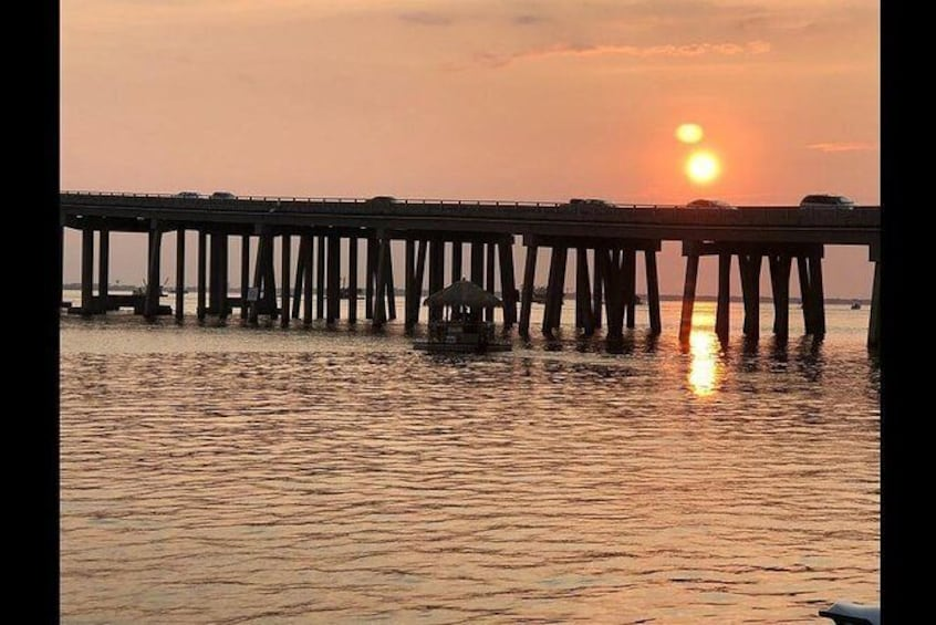 Show item 4 of 7. Tiki Sunset Cruise