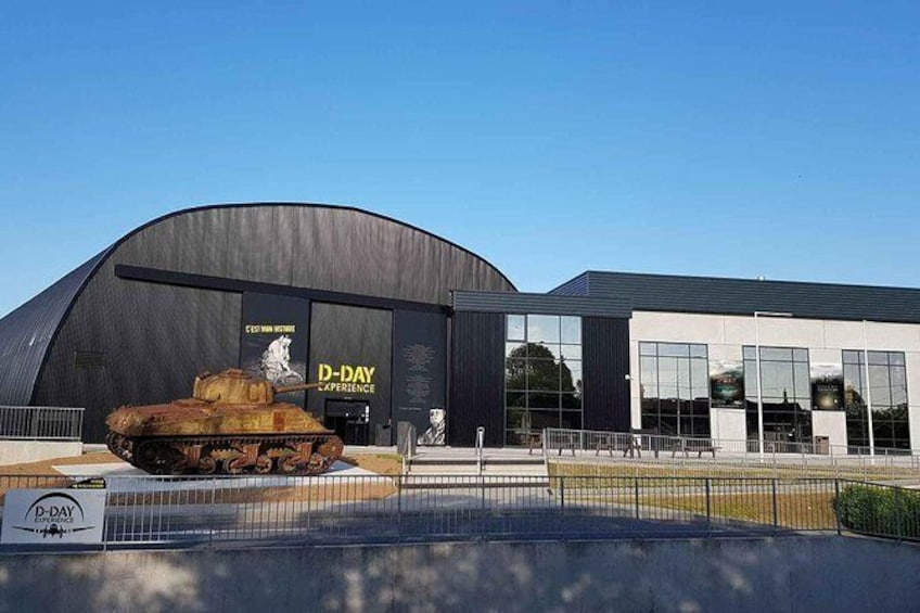 Show item 1 of 10. D-Day Experience Museum Entrance with real C-47 simulator and 3D cinema