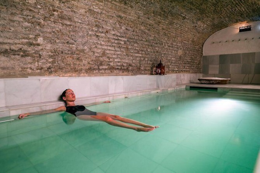 Show item 1 of 10. Skip the Line: AIRE Ancient Baths Sevilla Thermal Baths Admission Ticket