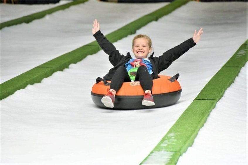 Show item 1 of 10. Pigeon Forge Snow: Indoor Snow Tubing Admission