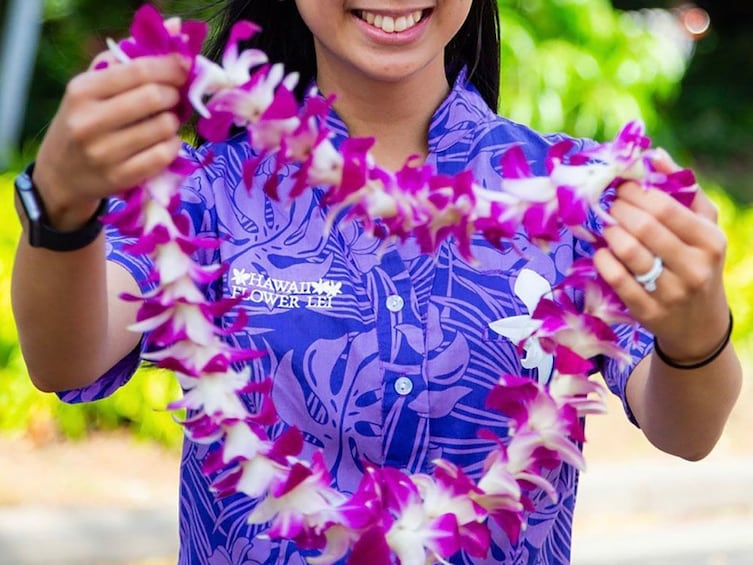 Show item 1 of 3. Classic Orchid Lei Greeting at Lihue Airport