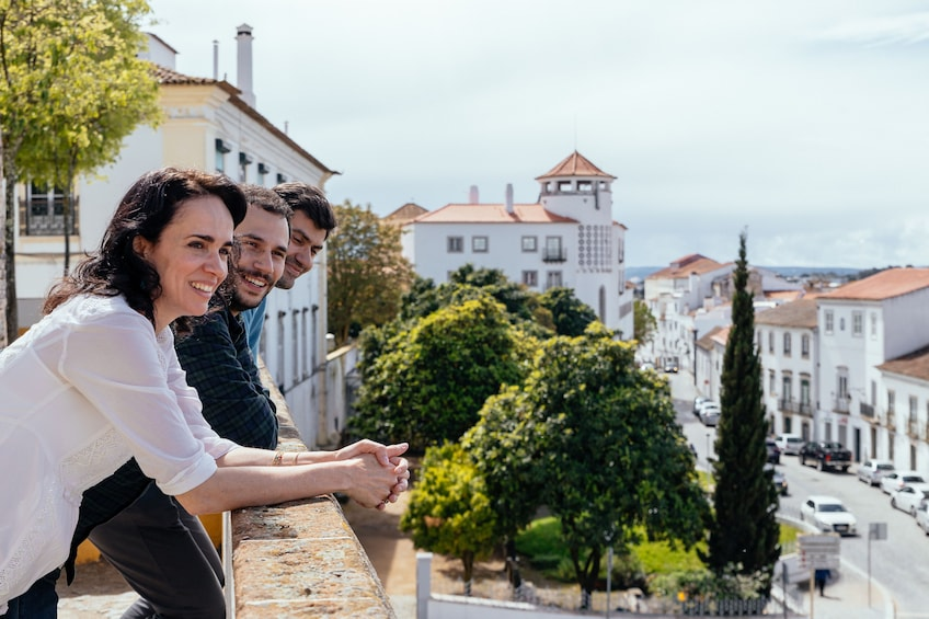 Show item 1 of 9. Tourists enjoying the view in Evora