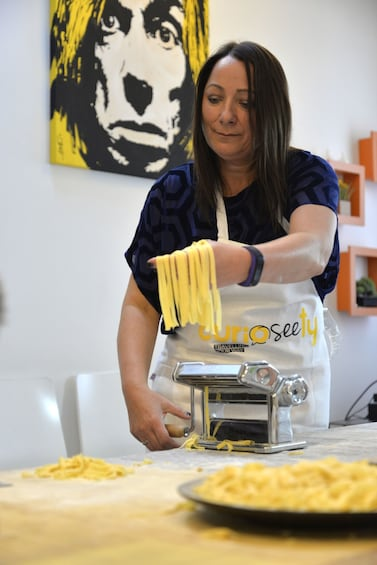 Show item 3 of 6. Woman making pasta in Cogoleto