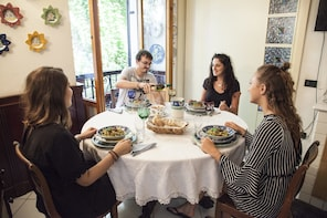 Dining experience at a local's home in Lucca
