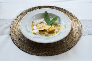 Dining experience at a Cesarina's home in Bergamo