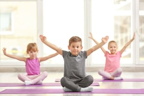 Kids yoga lessons by the water at Dolphin Wellness