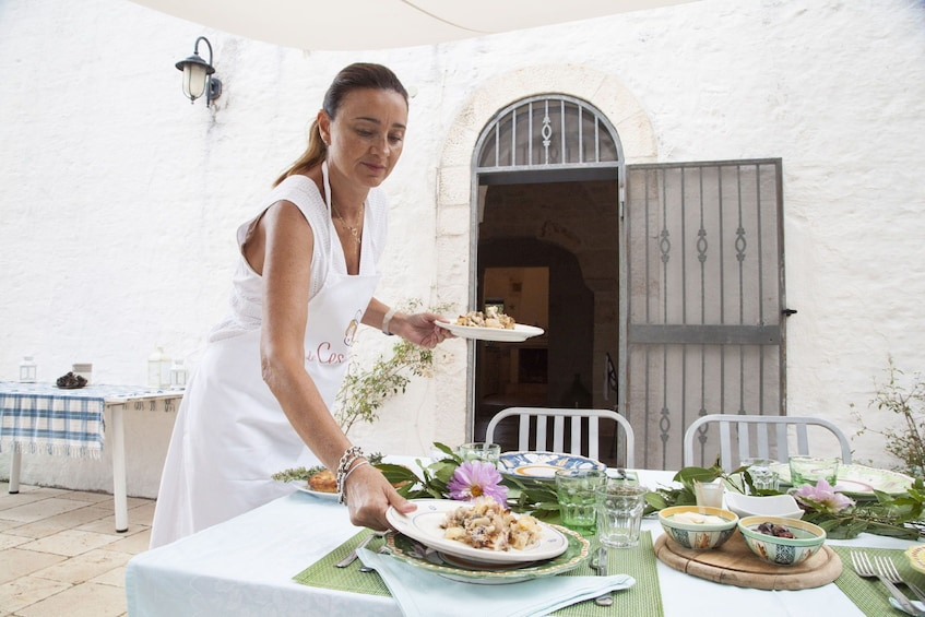 Show item 3 of 7. Dining experience at a Cesarina's home in Ostuni