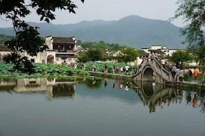 Morning Half-Day Hong Village Seat-In-Coach Tour