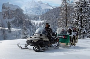 Snowmobile + Sledding in the Dolomites Private Experience