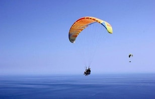 Fly with professional paragliding tandem pilots in Cinque Terre or Nord Tus...